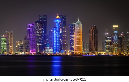 Doha city skyline illuminated at night. Qatar, Middle East