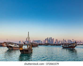 Doha Corniche Doha, Qatar - February 1, 2016: The modern architecture of the doha skyline as background for boats in Doha, the capital of the Arabian Gulf country Qatar on February 1, 2016