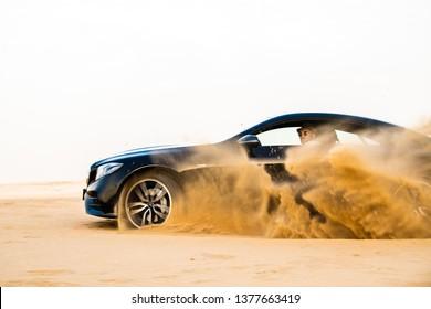 Doha, Doha/Qatar - April 19, 2019 : Black Mercedes Benz E53 AMG at Qatar Desert