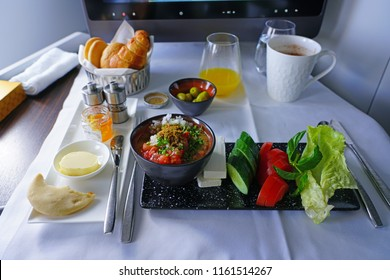 DOHA, QATAR -10 JUL 2018- View of an Arabic mezze tray with foul mudamas in Business Class on Qatar Airways (QR), the national flag carrier of Qatar.