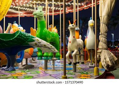 Doha / Qatar - 11/22/2019: empty funfair rides at night, at Doha Museum of Islamic Art park (MIA park)