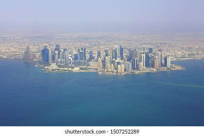 DOHA, QATAR -17 JUN 2019- Aerial view of the modern skyline of downtown Doha. The capital of Qatar will host the 2022 FIFA World Cup of soccer.
