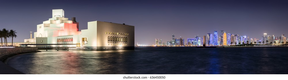 DOHA, QATAR - 1st April 2017: Panorama from the Museum of Islamic Art to the Skyline of Doha by night