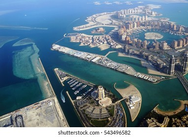 DOHA, QATAR -21 DEC 2016- Aerial view of Doha and the Pearl City area. The capital of Qatar will host the 2022 FIFA World Cup of soccer.