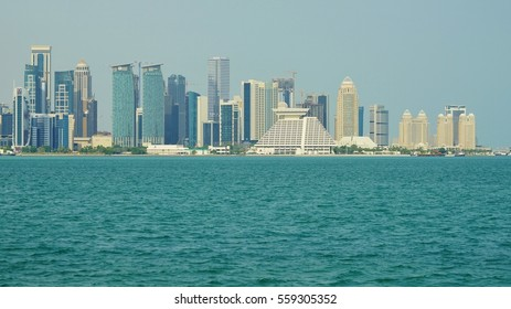 DOHA, QATAR -22 DEC 2016- View of the modern Doha skyline  on West Bay. The capital of Qatar includes many supertall highrise skyscrapers.