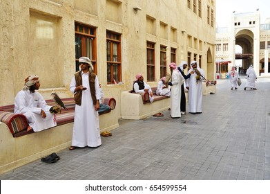 DOHA, QATAR -22 DEC 2016- Qatari men with hunting falcons at the Falcon Souq, a market selling live falcon birds and falconry equipment located in the center of Doha.