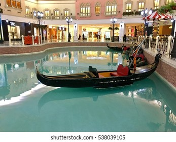 Doha, Qatar - 25th October 2016: Gondola in artificial canal, in Villagio mall, Doha, Qatar