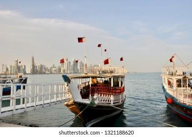 Doha, Qatar - 28th January 2019: Anchored tourist Dhows in Doha harbour. Qatar