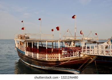 Doha, Qatar - 28th January 2019: Tourist traditional Dhow boat at corniche of Doha, Qatar