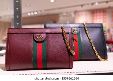 DOHA, QATAR - 31 OCT 2019: Luxury leather hand bags display on Gucci store shelf in Hamad International Airport. Gucci is an Italian luxury brand of fashion and leather goods.