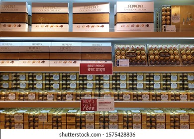 DOHA, QATAR - 31 OCT 2019: Ferrero Rocher premium chocolate store in Hamad International Airport. Ferrero Rocher is a spherical chocolate produced by the Italian chocolatier Ferrero SpA.