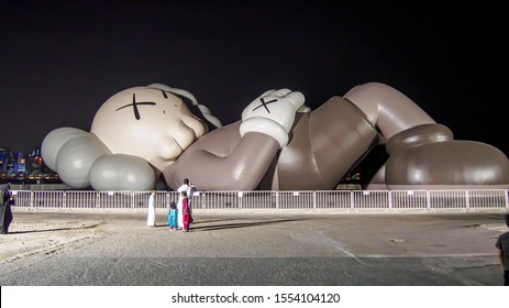 Doha, Qatar - 8 NOV 2019: Kaws' Holiday lands in Doha, Qatar. The 40m high sculpture represents the artist's attempt to remind passersby to relax in an increasingly hectic world.
