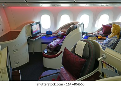 DOHA, QATAR -9 JUL 2018- View of Business Class seats on a Qatar Airways (QR) Boeing 787 Dreamliner airplane. The Gulf airline has excellent service.