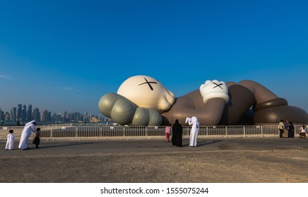 Doha, Qatar - 9 November 2019 : People Are Visiting the Famous Kaws Holiday Sculpture Displayed at the Doha Corniche