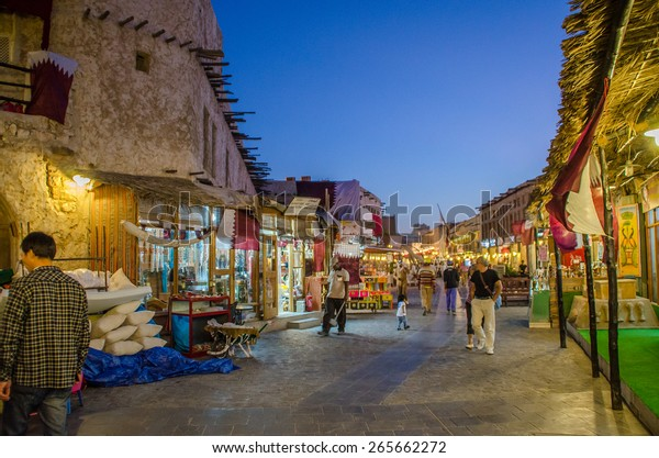 DOHA, QATAR - April 1, 2015: Souq Waqif is a main marketplace and a popular tourist attraction selling traditional garments, spices, handicrafts, and souvenirs.