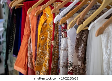 Doha, Qatar - April 10, 2020: Indian Pakistani traditional bridal dresses. Dresses on hangers in a clothing store