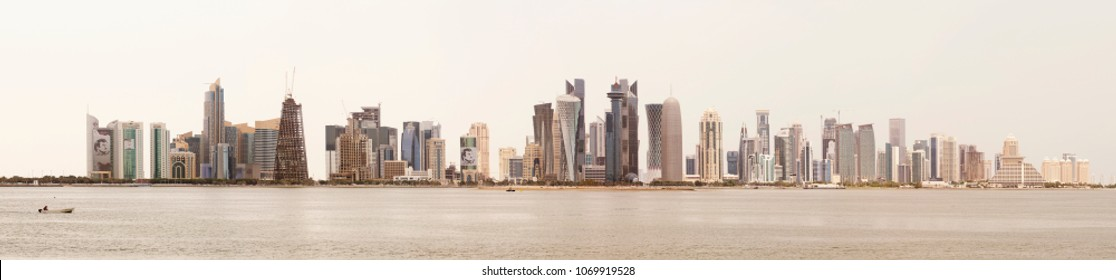 DOHA, QATAR - April 16, 2018: Panoramic view of Doha's towers against an overcast sky. High resolution stitched file