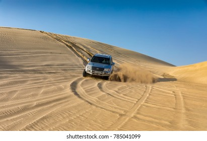 Doha, Qatar - April 1st 2017: Sand dune bashing in the desert of Qatar with a 4x4 vehicle