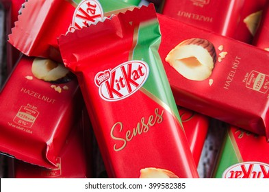 DOHA, QATAR - APRIL 2, 2016: Kit Kat Senses Rich In crunchy Hazelnut Pieces on wooden background. Kit Kat bars are produced by Nestle. Brand Kit Kat was registered in 1911