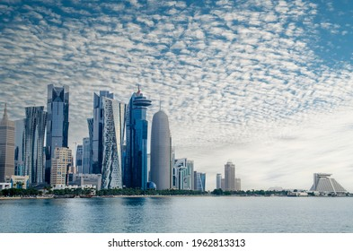 Doha, Qatar - April 2021: The skyline of the modern and high-rising city of Doha in Qatar, Middle East. - Doha's Corniche in West Bay, Doha, Qatar.