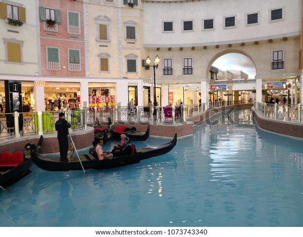 DOHA, QATAR - APRIL 21: Canal and Gondola inside of the Villaggio Mall Shopping Center in Doha on April 21, 2018. Doha, Qatar, Middle East.