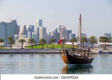 DOHA, QATAR - April 7, 2018: A traditional sailing dhow, complete with mast, moored  in the Museum Lagoon in Doha, Qatar