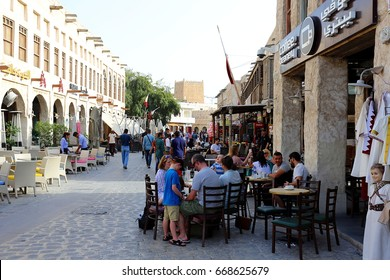 DOHA, QATAR - APRIL 9, 2017: Tourists relax at one of many cafes in Souq Waqif market in Doha.