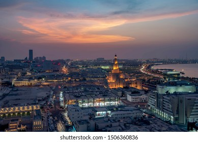 Doha, Qatar - August 20, 2019: Ariel View of Doha City with Iconic Doha Fanar Mosque sunset time