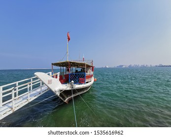 Doha, Qatar- August 9 2019. Dhows are iconic water taxi Qatar history. A traditional boat made from wood.Can be found at Doha corniche. A fishing or pearl boat in the past.A heritage for qatari people