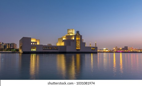 DOHA, QATAR - CIRCA JAN 2018: Doha skyline with Museum of Islamic Art in Doha day to night transition timelapse, Qatar, view with buildings and boats behind it