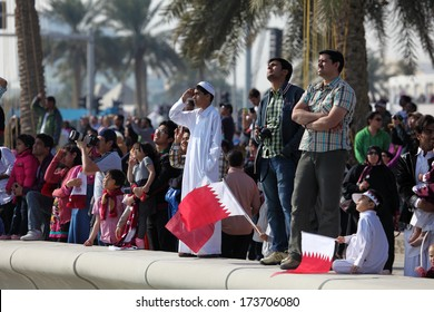 DOHA, QATAR - DEC 18: Spectators watching the Qatar National Day Air Show from the Corniche. December 18th 2013 in Doha, Qatar, Middle East