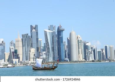 Doha, Qatar - December 14, 2018: Beautiful Skyline of Doha City with dhow boats