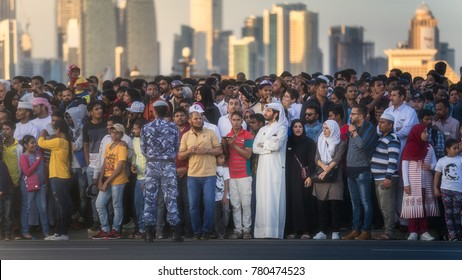 Doha, Qatar - December 18, 2017: A crowd of people watching  military and civil machines on Qatar National Day parade on the Corniche street, Doha, Qatar