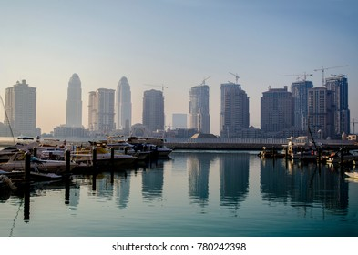 DOHA, QATAR - DECEMBER 2017: The Pearl-Qatar is an artificial island in Qatar. View of the Marina in Porto Arabia on December 22 nd 2017 in Doha, Qatar, Middle East