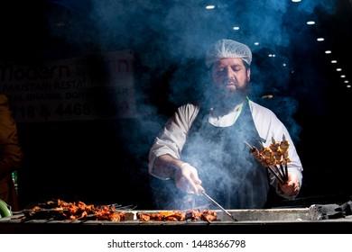 Doha, Qatar - December 21, 2018:  A Chef Making Bar B Que Chickan Tikka