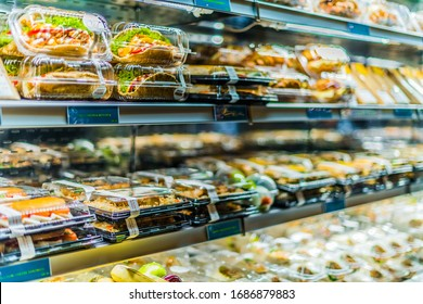 DOHA, QATAR - FEB 28, 2020: Pre-packaged sandwiches, salads and drinks displayed in a commercial refrigerator