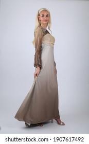 Doha, Qatar - February  02, 2021: :Arab Female model in Arab Traditional  Dress  on white background .