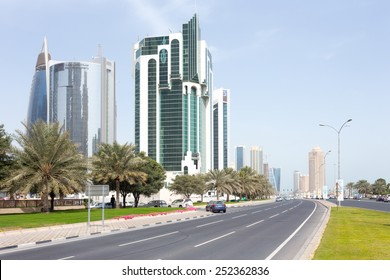 DOHA, Qatar - February 11, 2015: The Corniche road with the Public Works Authority, Salaam Tower and Doha Bank tower.