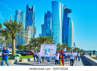 DOHA, QATAR - FEBRUARY 13, 2018: The holiday parade on Corniche promenade in Al Dafna district during the celebration of National Sports Day, on February 13 in Doha.