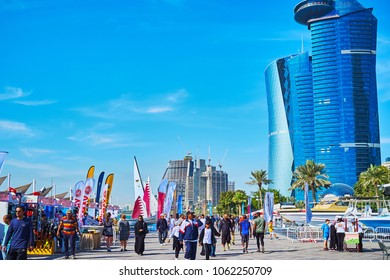 DOHA, QATAR - FEBRUARY 13, 2018: The crowded yacht fair is timed to the Day of Sport and held next to Sheraton Park in Al Dafna district, on February 13 in Doha.
