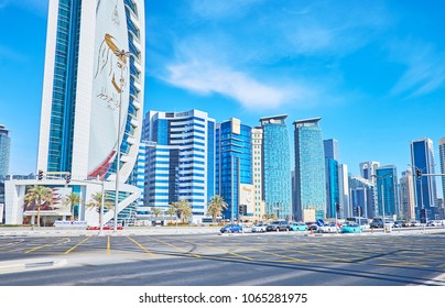 DOHA, QATAR - FEBRUARY 13, 2018: The view on glass skyscrapers of West Bay neighborhood from the Sheraton intersection - the wide roads of Corniche and Funduq streets, on February 13 in Doha.
