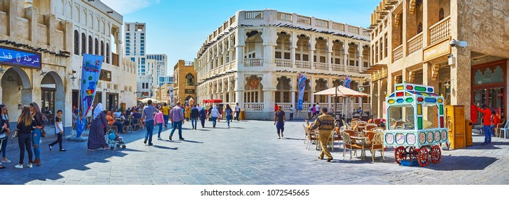 DOHA, QATAR - FEBRUARY 13, 2018: Panorama of Souq street in Souq Waqif neighborhood, restored historical area with perfect examples of authentic residential and trade buildings, on February 13 in Doha