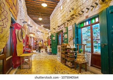 DOHA, QATAR - FEBRUARY 13, 2018: The curved alley of the Souq Waqif with numerous handicraft stores and art galleries, on February 13 in Doha