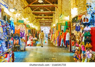 DOHA, QATAR - FEBRUARY 13, 2018: Visit traditional Eastern Souq Waqif with narrow alleyways, full of different goods and noisy vendors, on February 13 in Doha