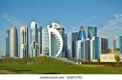 DOHA, QATAR - FEBRUARY 17, 2016: The high-rise district of Doha, seen from the recently completed Hotel Park, with and artificial hill in the foreground.