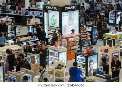 DOHA, QATAR - FEBRUARY 18, 2014: Tourists shopping at Duty Free Shop at Doha International Airport, the only commercial airport in Qatar.
