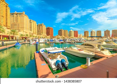 Doha, Qatar - February 18, 2019: luxury port walkway of Porto Arabia at the Pearl-Qatar, Doha. Persian Gulf in Middle East. Sunny day, blue sky.