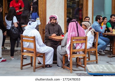 Doha / Qatar - February 18, 2020: Muslim people sitting outdoors at tea shop in Doha downtown