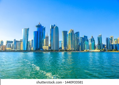 Doha, Qatar - February 20, 2019: Qatar International Exhibition Center, Doha Tower, Salam Tower, World Trade Center and Doha Bank Tower see from dhow in Financial District, West Bay skyline.Copy space