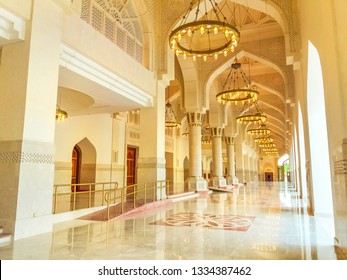 Doha, Qatar - February 21, 2019: interior of atrium in Imam Abdul Wahhab Mosque with lit chandeliers. Qatar State Mosque in Middle East, Arabian Peninsula. The Grand Mosque is located in West Bay.